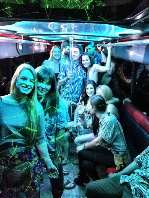 Laser-Lights-And-Girls-Smiling-In-A-Large-Partybus