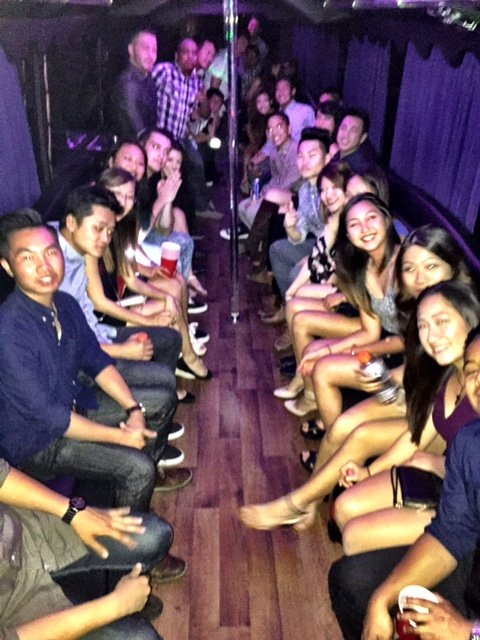 Relaxed-Group-Of-People-Leaving-For-Omnia-In-Downtown-SD-Inside-A-Extra-Large-Party-Bus