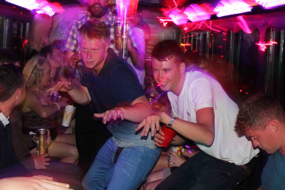 Two Guys Bus Surfing inside the Party Bus.JPG