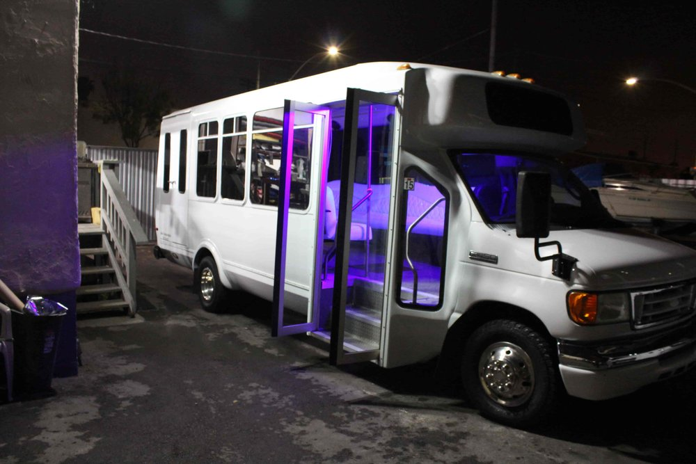 Petite White Limo Bus with Purple Glow from Interior