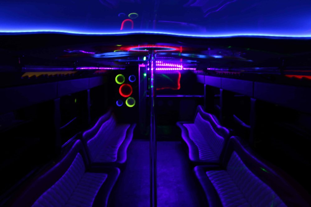 Patriot Limo Bus with a dark light glow