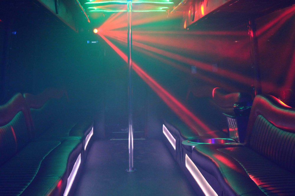 Patriot Limo Bus with red lasers cutting through the fog