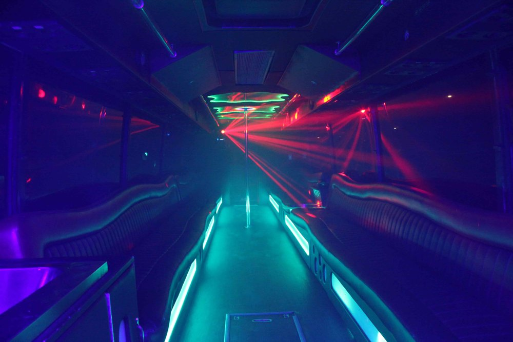 Great long shot of Patriot Limo Bus with a backlit red laser light glow