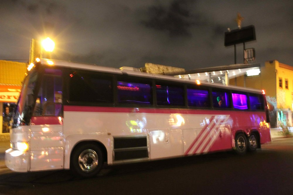 Side Shot of the Pink Party Bus in Downtown San Diego