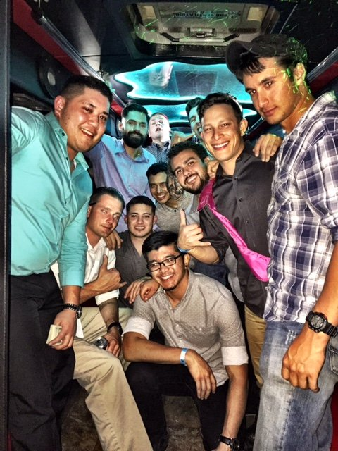 guys posing for a special event party bus picture.jpg
