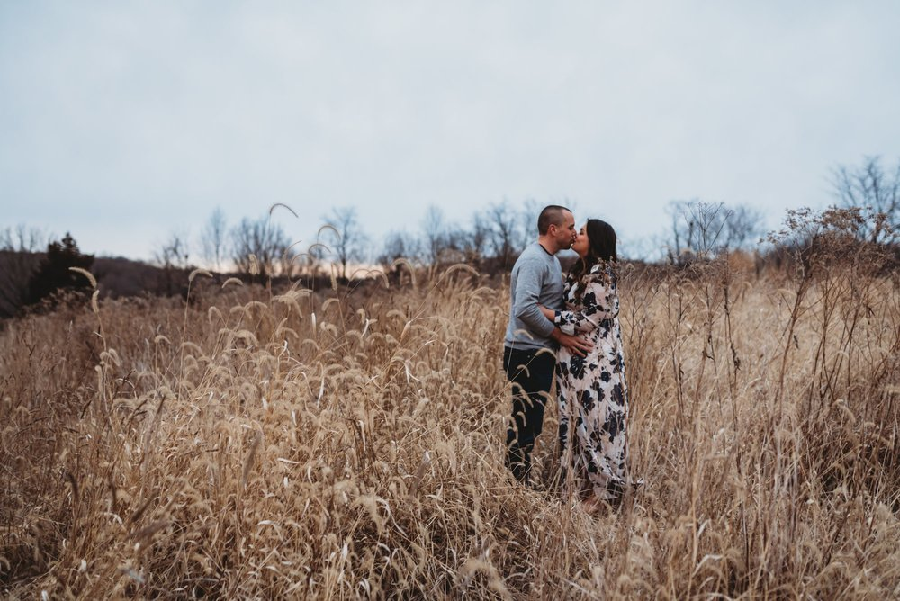 couple kissing in field