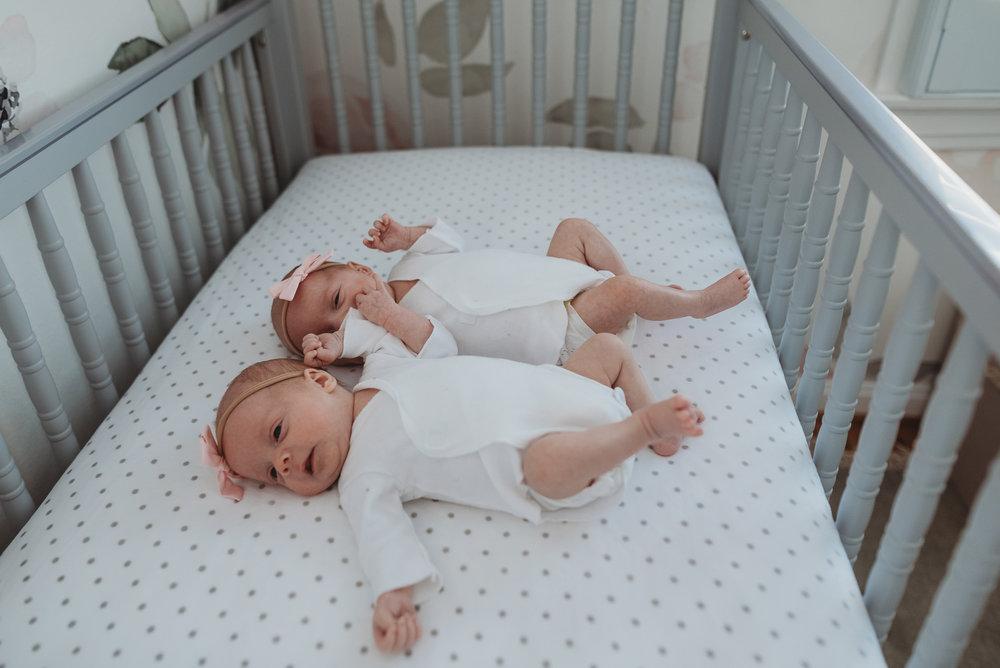 twin girls in crib