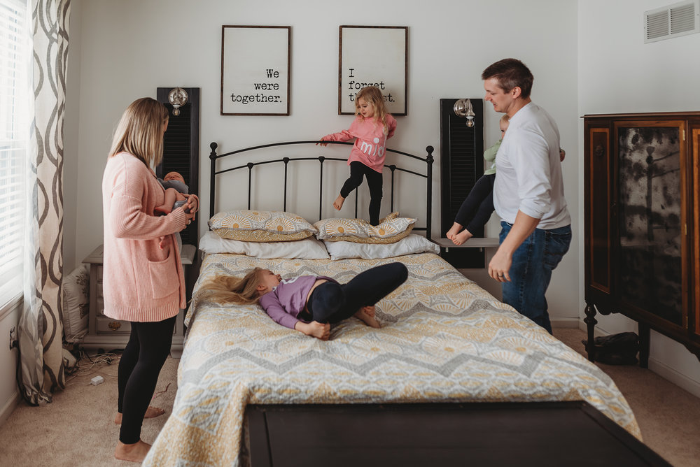 family in master bedroom