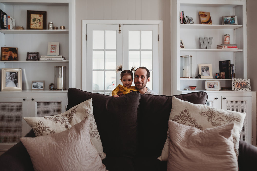 dad playing with little girl
