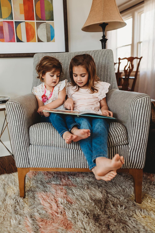 girls on chair reading - St. Louis newborn photographer
