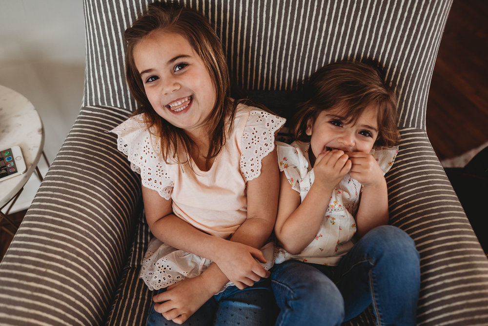 sisters laughing- Saint Louis Photographer