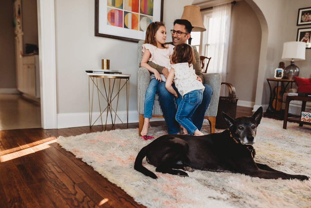 dad and daughters with dog