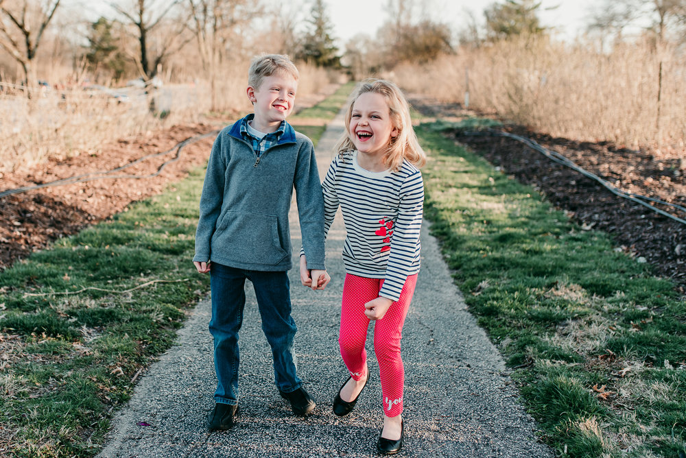 siblings laughing together- St. Louis family photographer