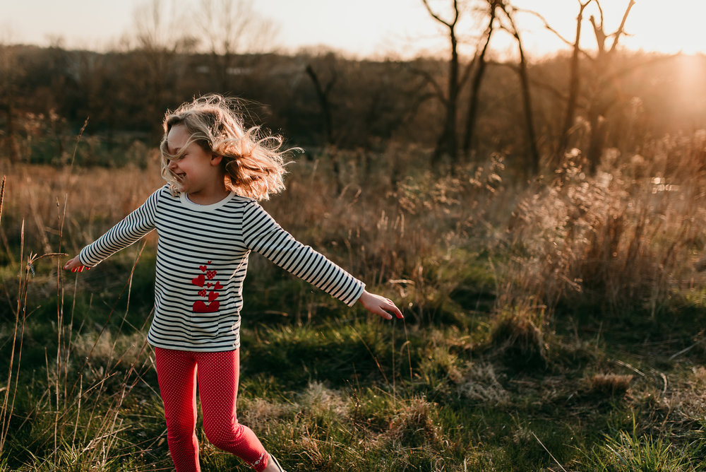 girl dancing in the sunset