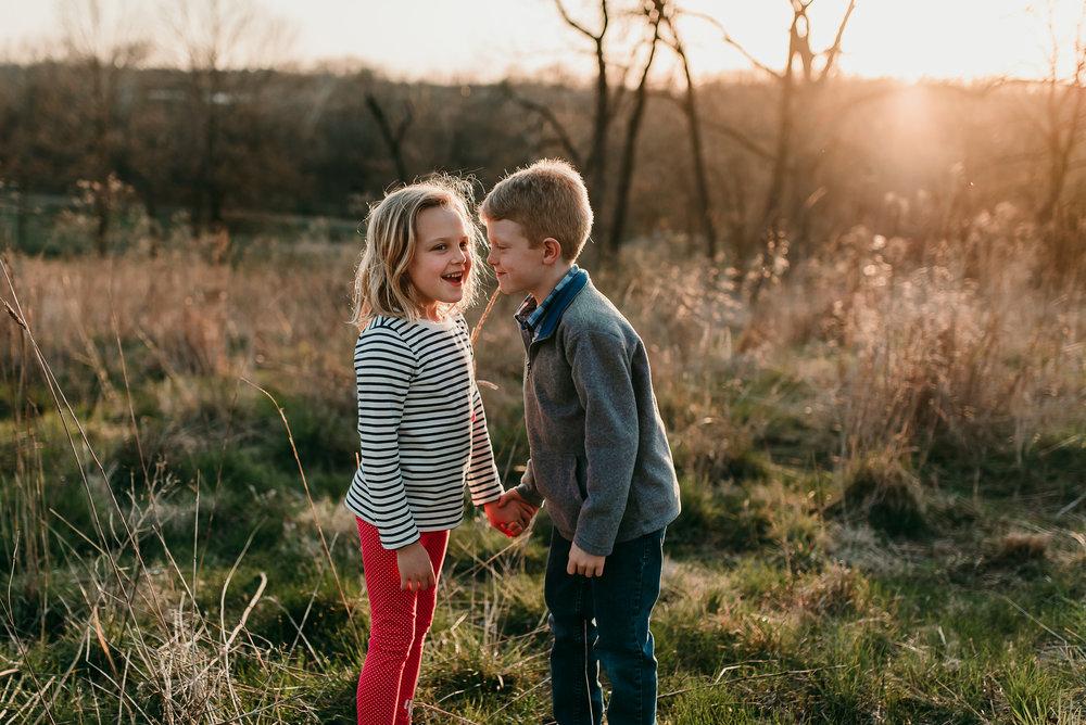 siblings telling a secret