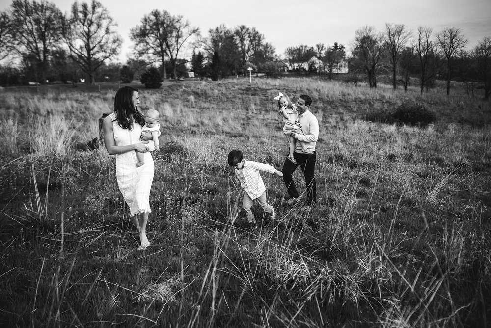 family walking through a field together