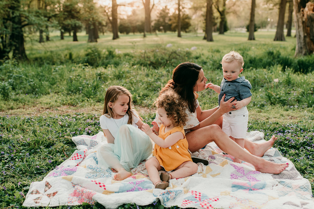 mom with 3 children on blanket