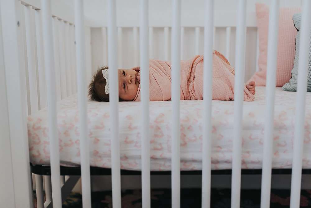 baby girl in crib