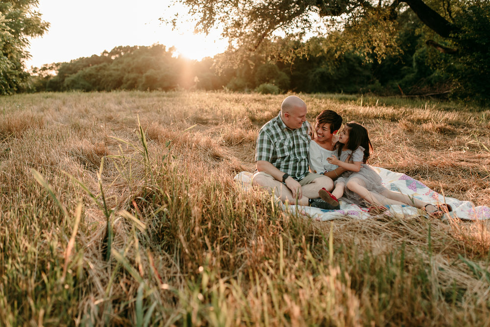 golden hour light with family on a blanket