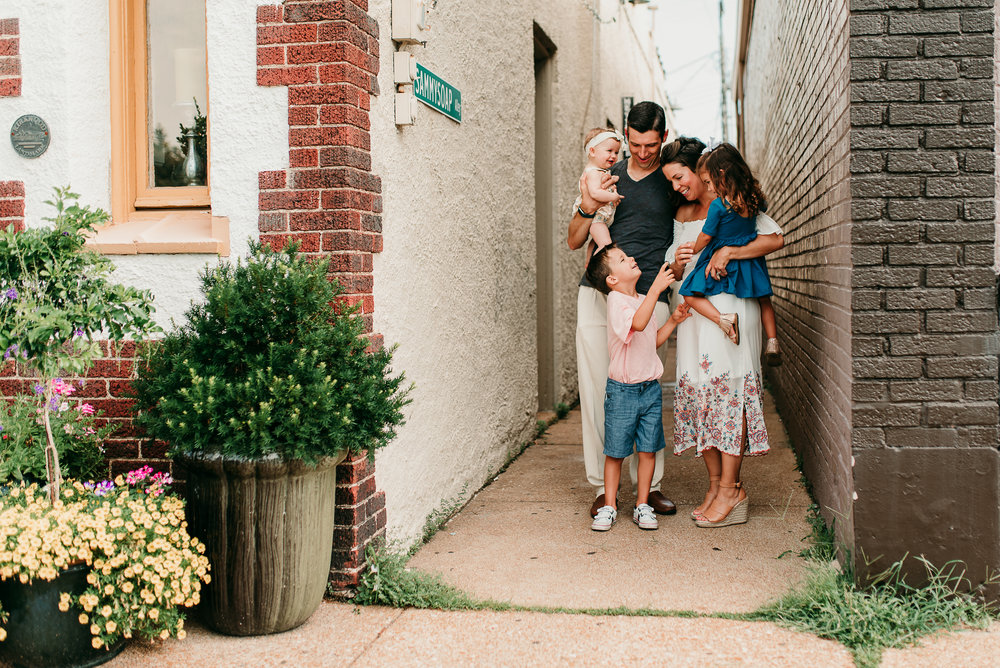 family gathered in alleyway