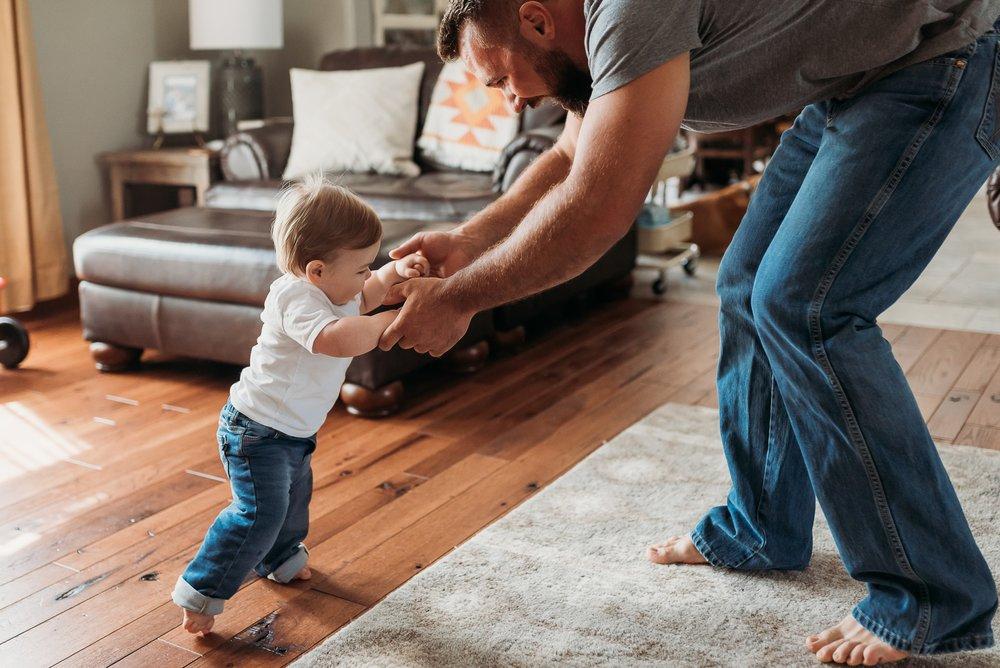 little boy walking with daddy