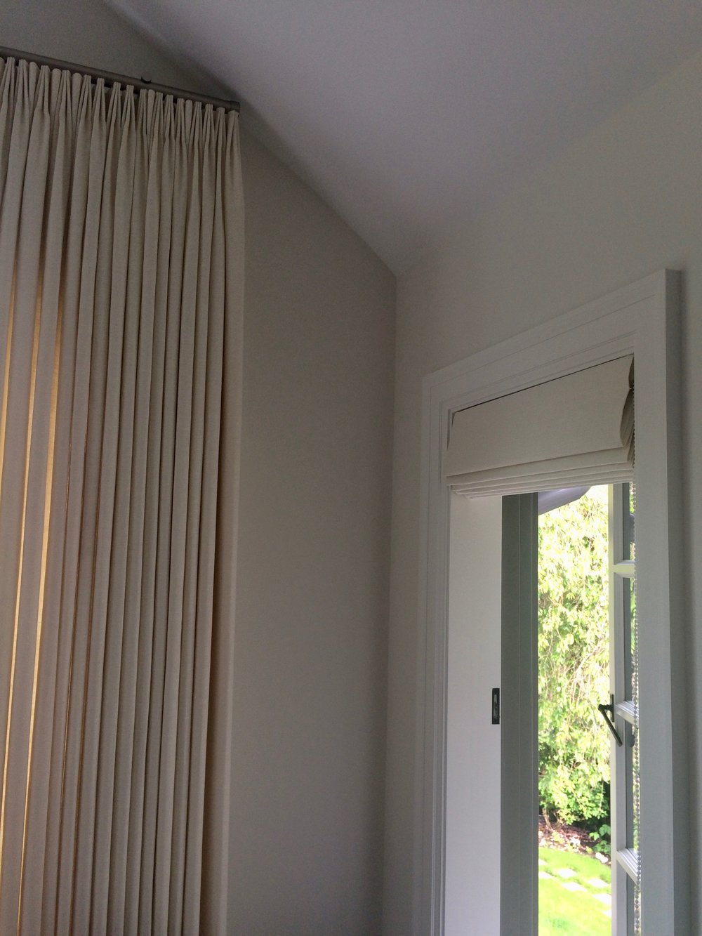 Linen curtains and roman shades