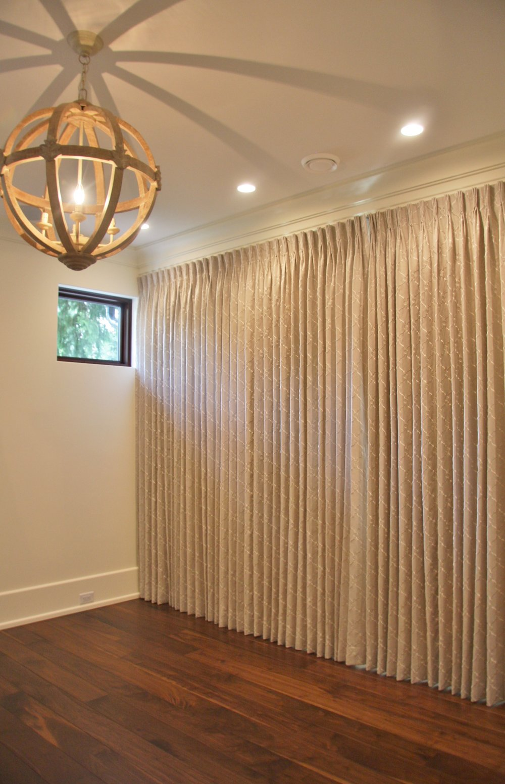 Wall to wall custom pinch pleat drapes