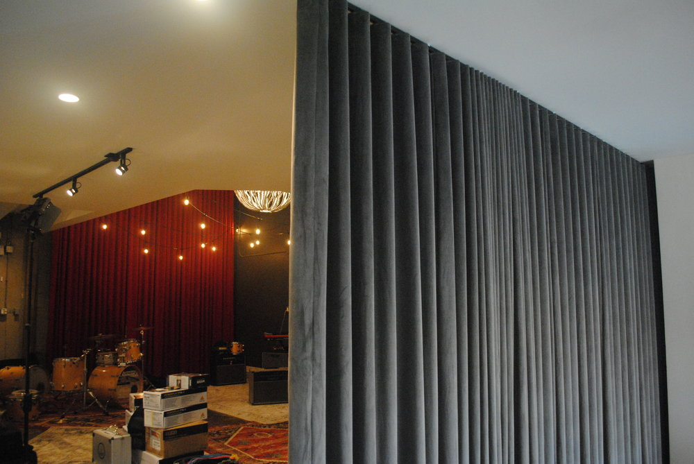 Velvet ripple fold drapes on a CS Track