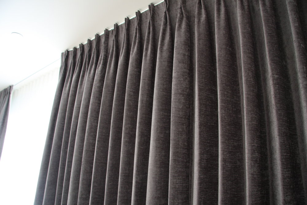 Pinch pleat drapes in a chenille velvet