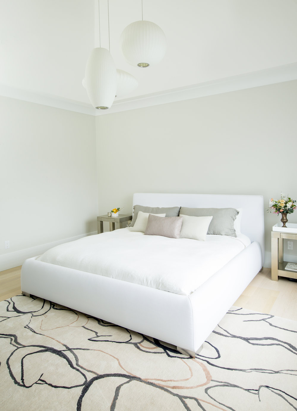King bed with a white washable slipcover