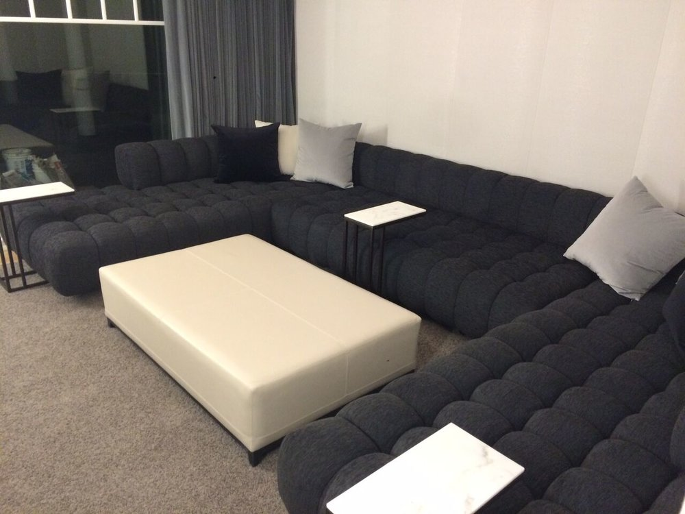 Custom marshmellow sofa sitting cozy with upholsterewd walls