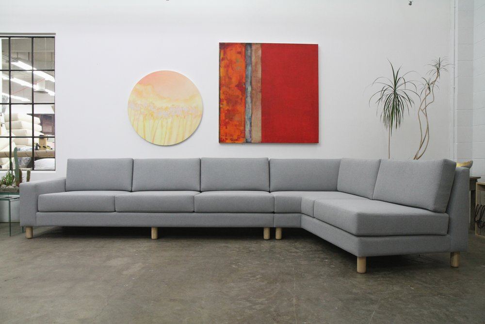 custom sectional with a 101.1 degree bend because measured architecture never builds a cabin with an ordinary square wall!.JPG
