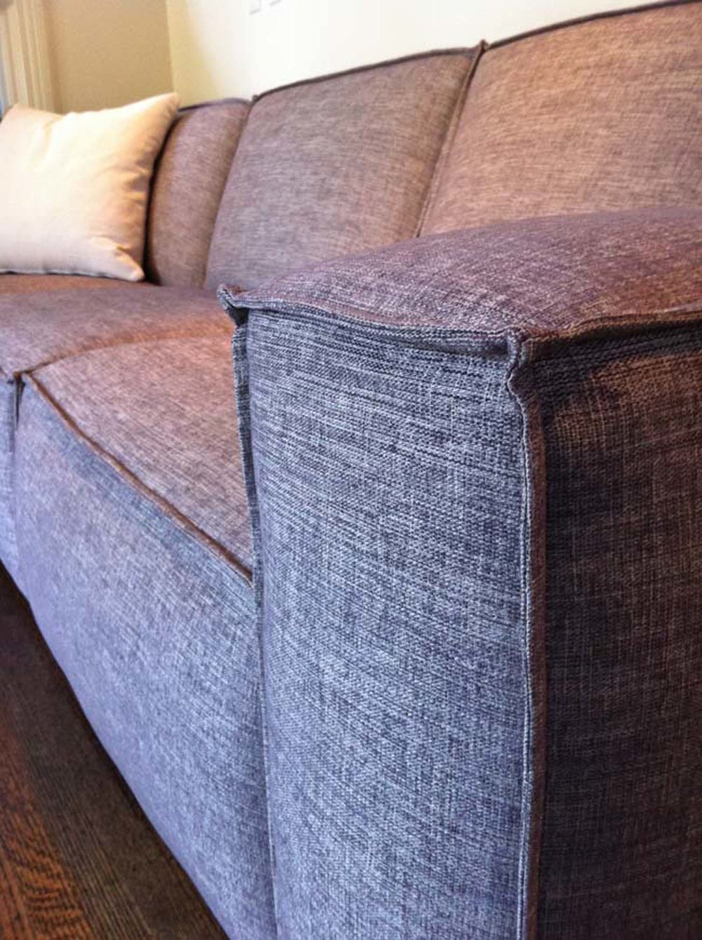 Pops sofa with French seam trim