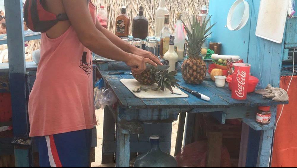 See, this is probably a scenario in which the fruit is OK to eat, since I physically watched it being prepared, and it's fruit with a rind, so the pineapple itself wasn't washed in water that might not agree with your stomach.