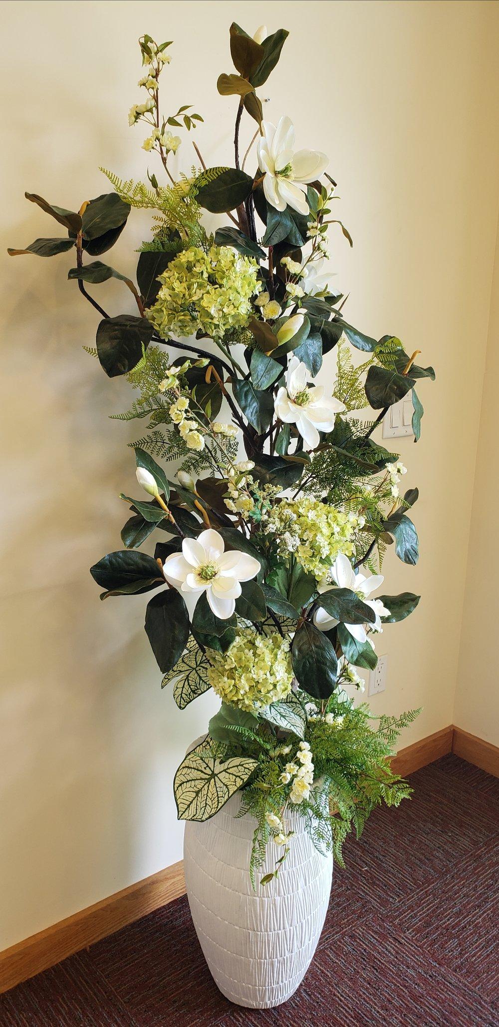 Magnolia Arrangement in tall vase