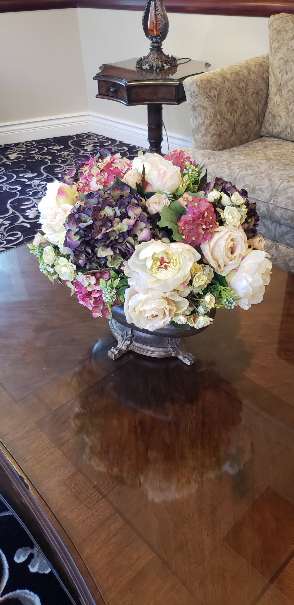 Arrangement on coffee table in hotel lobby