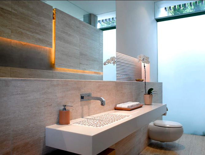 Two basins sit in front of a plate glass window with floating mirrors. This keeps the view in tact. Organically shaped basins blend with nature
