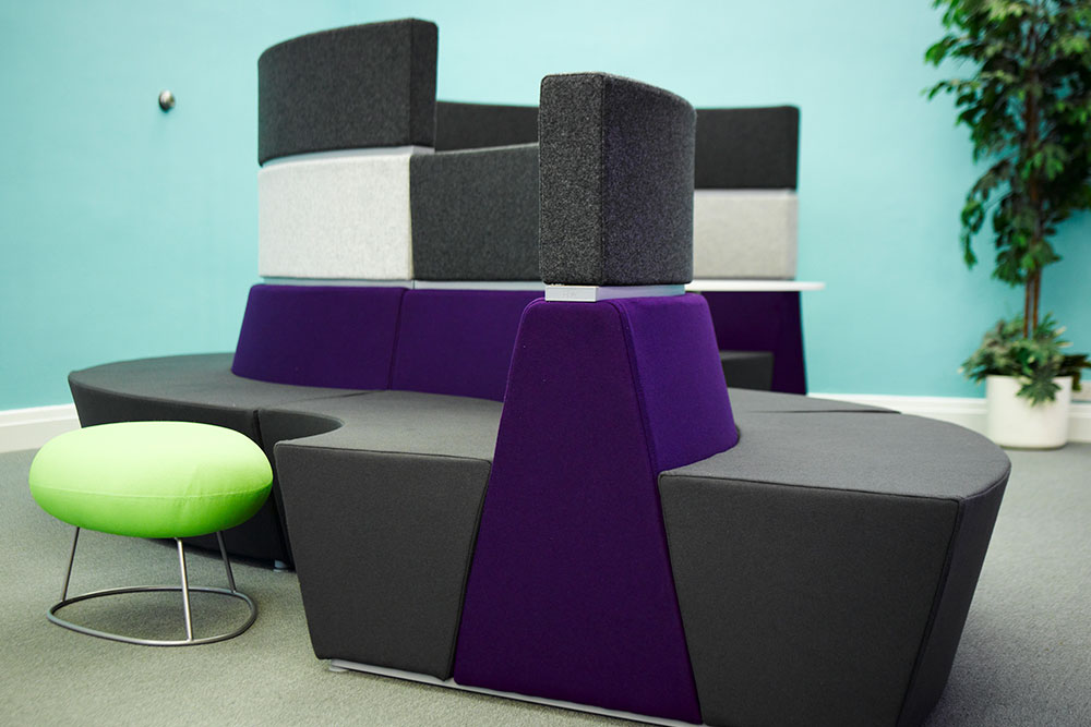 Curved furniture used in the reception space of our work at PERA.