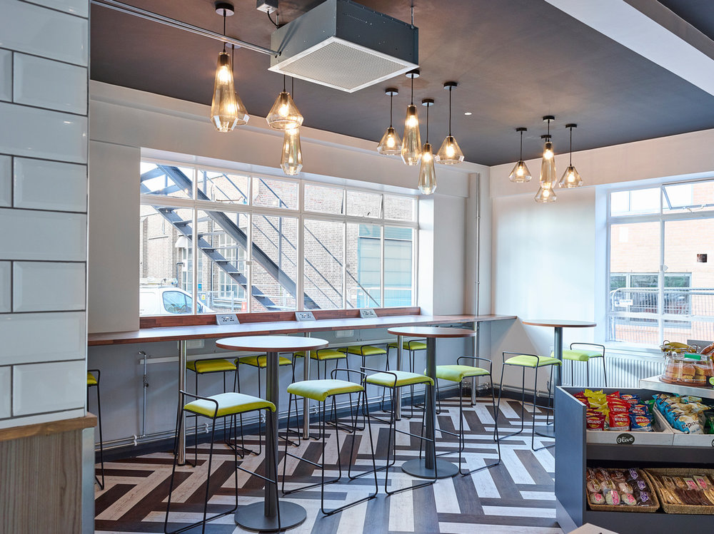 One area of the work cafe in the social hub we designed and delivered at  MIRA Technology Park .
