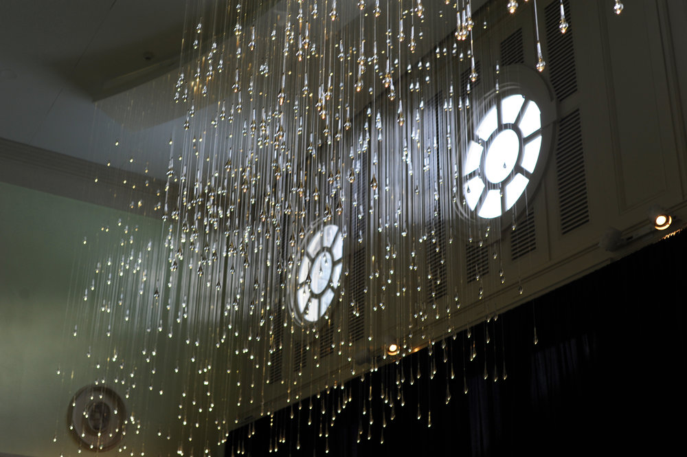 Light Shower: A site specific installation of 1,400 teardrop-shaped diffusers in the Mansion Loggia.