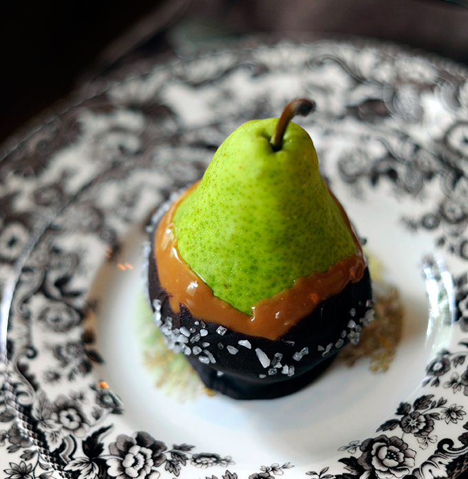Caramel and dark chocolate covered pear dusted in sea salt