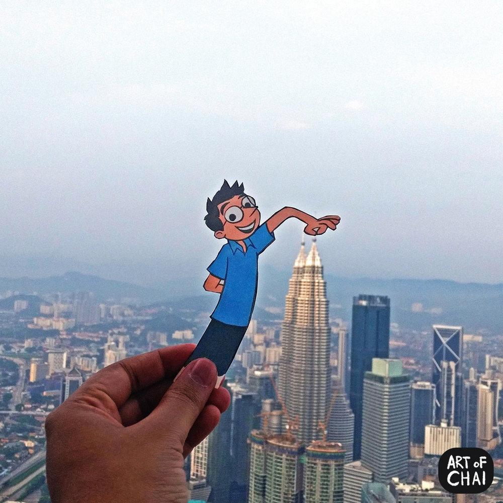 Chai doing touristy things in Kuala Lumpur.