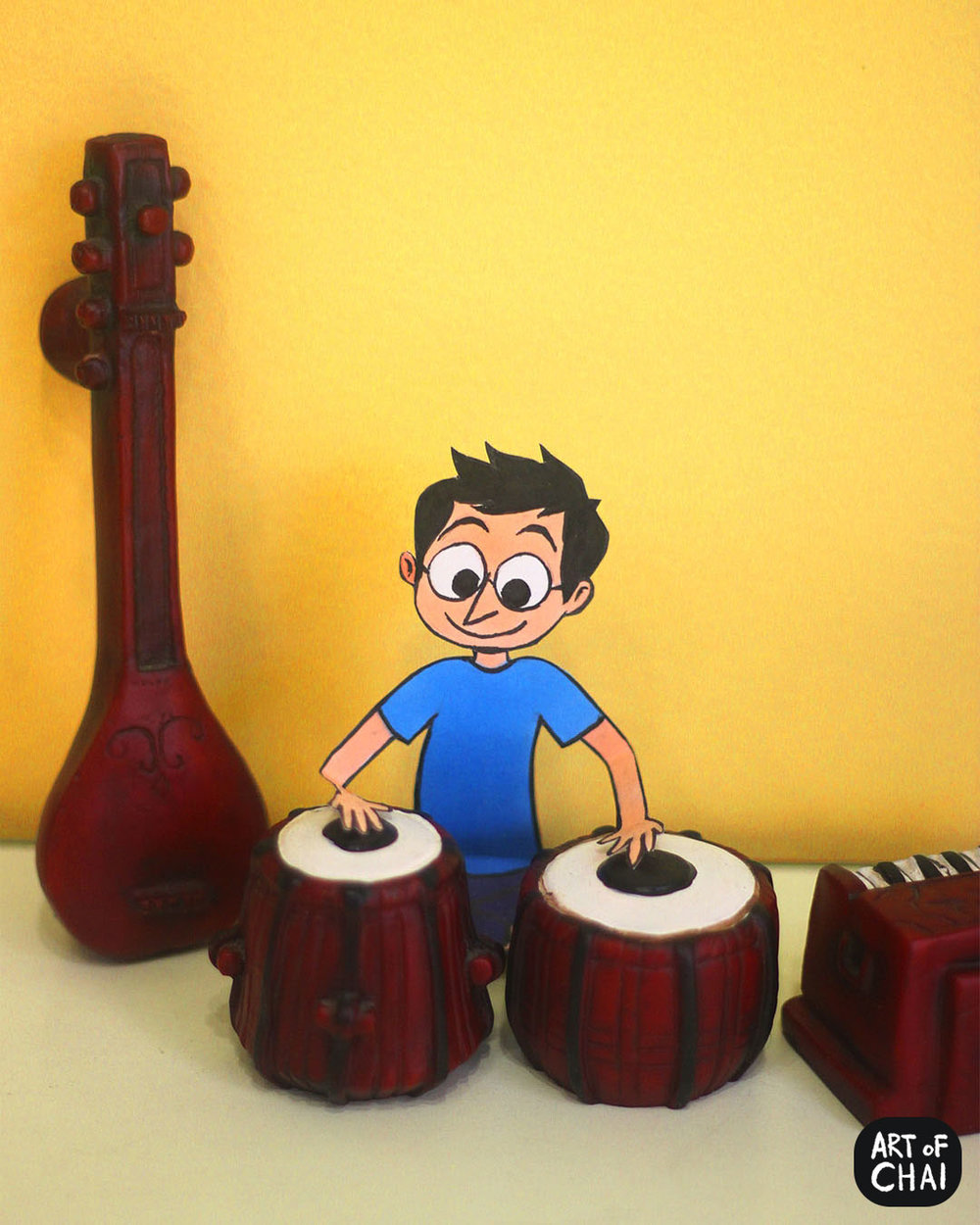 Chai trying out the tabla on the occasion of World Music Day.