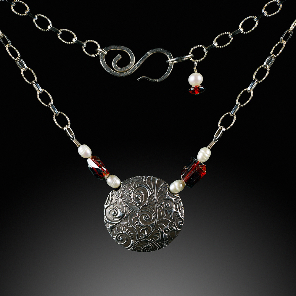 PamHurst-Patterned_Silver_Lentil_Necklace_with_garnets_and_Pearls-72-2722.jpg