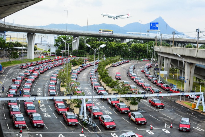 The main taxi queue at Hong Kong's world class Chek Lap Kok Airport on Lantau Island. Red cabs to Hong Kong Island and Kowloon, Green cabs to the New Territories and Blue cabs to destinations on Lantau. When time is of the essence, I often take clients directly to Victoria Peak in a red cab.