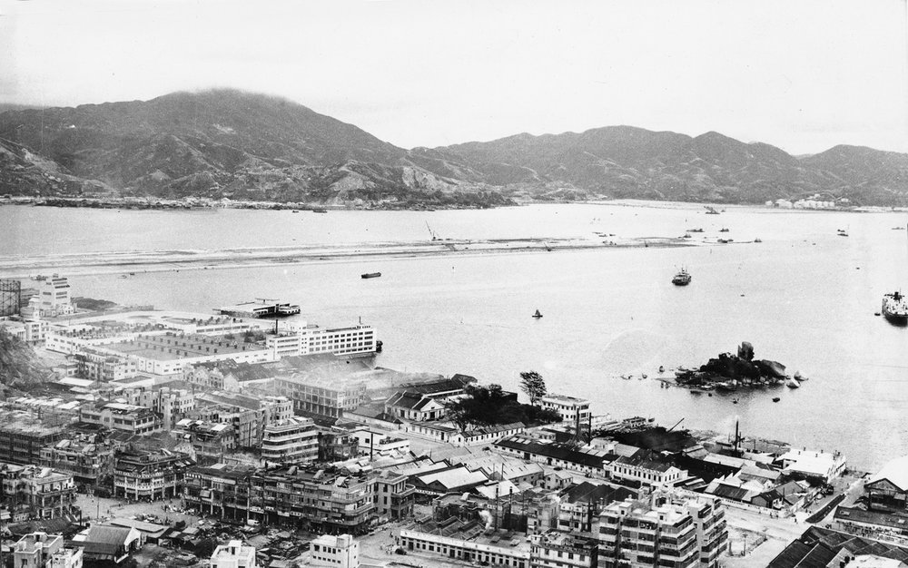 The infamous old Kai Tak Airport runway viewed next to my neighborhood, old To Kwa Wan. The small island you see to the right is now a public park surrounded by reclaimed land. The low buildings you see, with one or two exceptions are all gone. I watched a number getting torn down. The neighborhood is vintage 50-60-70's in many respects, with modern high rises rapidly cropping up.