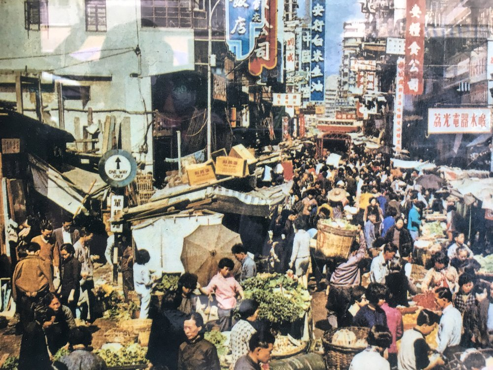 "A bit of raw Cantonese street culture circa 1950's. This street looks substantially the same today. A quintessential example of    ""messy urbanism""    and a street photographer's wet dream."