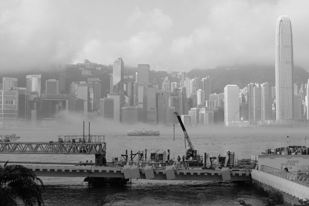 THE FOG, March 5,  2018  (All Rights Reserved, William Banzai7)  The fog creeps in  on little cat feet.  It sits looking  over harbor and city  on silent haunches  and then moves on.   THE FOG--Carl Sandburg   March and April are the foggy season in Hong Kong.  Caused by cold meets warm temperature inversions, one can expect wonderfully atmospheric image opportunities by the harbor and up on Victoria Peak in the early morning and in the evening. A great time for photographers visiting Hong Kong. Monitor the Hong Kong Observatory website for up to the minute local weather reports.  To view more of my images of Hong Kong and Macau, please visit my  Flickr Stream  or visit me on Instagram:  @williambanzai7 .   Hope to see you soon on the Streets of Hong Kong!   WB7  End of Dispatch