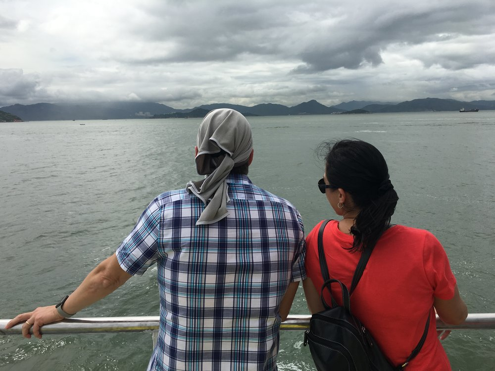 Enjoying scenic vistas from the outside deck of the Cheung Chau Ferry.