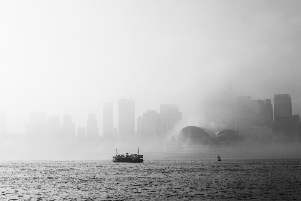 A solitary Star Ferry cruises mid-harbour in the morning fog of Spring.